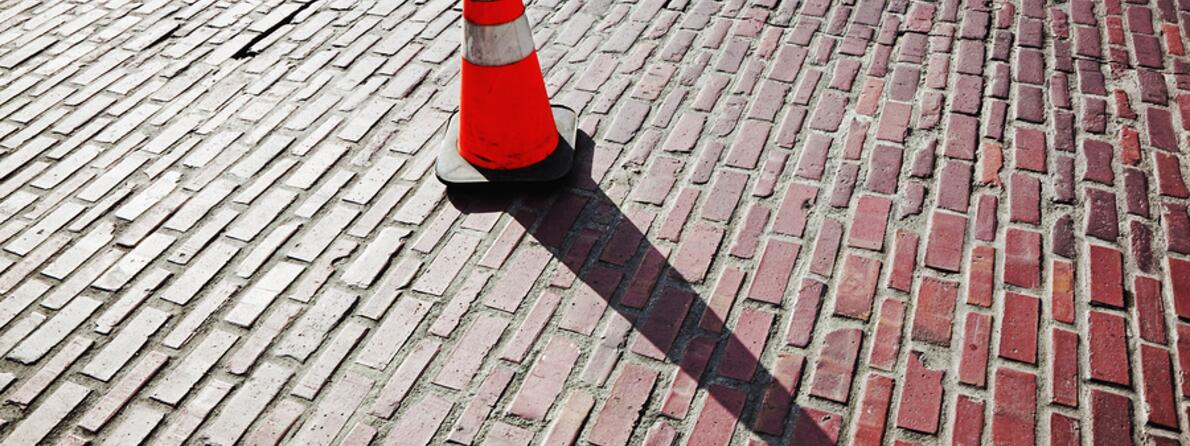 bigstock-Traffic-Cone-On-Brick-Street-7382976