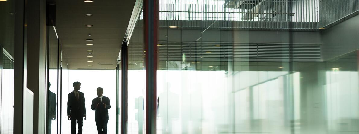iStock-544673428 men in corridor