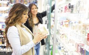 Two women shopping in a cosmetics store